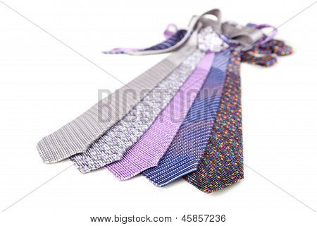 Some Stylish Silk Male Tie ( Necktie ) On White.