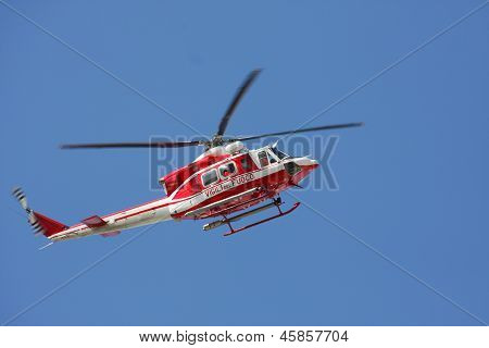Patrol Helicopter Of Firefighters In Blue Sky Over A Fire 1