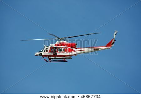 Patrol Helicopter Of Firefighters In Blue Sky Over A Fire 9