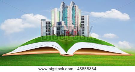 abstract of modern building on green grass field with blue sky background