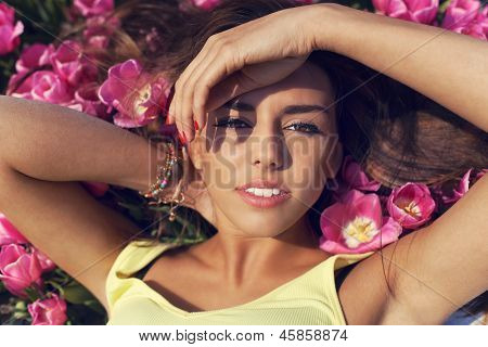 Beautiful Young Woman With In A Red Tulip Field