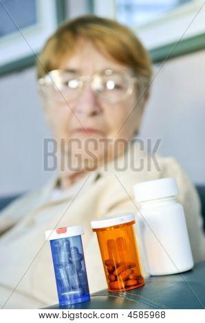 Elderly Woman With Pill Bottles