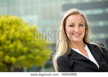 Portrait Of A Happy Business Woman Outdoors