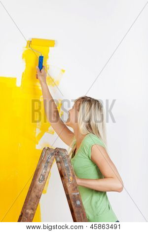 Woman Standing On A Ladder Painting