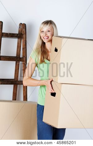 Woman Carrying Packing Cartons