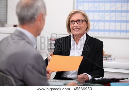 Mature woman working at her desk