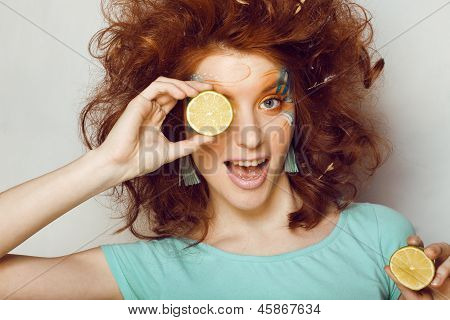 woman with creative make up and lime