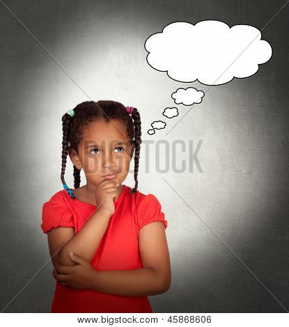 Doubtful little girl with a blank bubble on a over gray background
