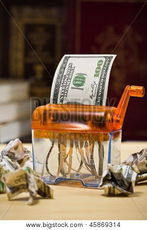 Dollar Banknote In A Paper Shredder Portrays  Decreasing Value Of  Money