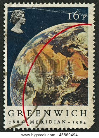 UK - CIRCA 1984: A stamp printed in UK shows image of the View of Earth from Apollo 11. Centenary of Greenwich Meridian, circa 1984.