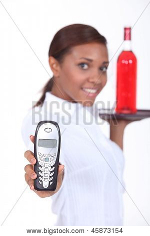 Waitress holding a telephone