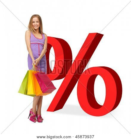 woman with shopping bags and big red percent sign