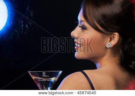 beautiful woman in evening dress with cocktail having fun