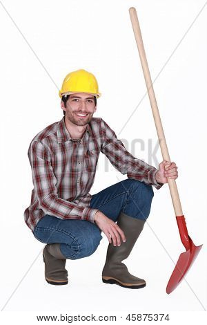 Man knelt down with spade