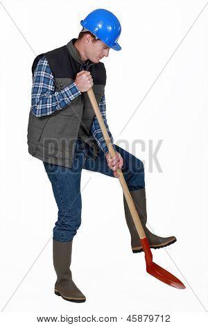 Labourer using a spade