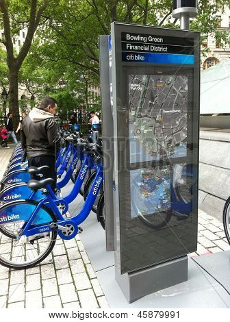 NEW YORK - MAY 24: A man looks at bicycles docked at a Citibike sharing kiosk at Bowling Green Station on May 24, 2013 in New York. Operated by NYC Bike Share, thousands of bikes will be available.