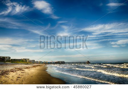 Historic fishing pier and beach scene at Cocoa Beach, Florida