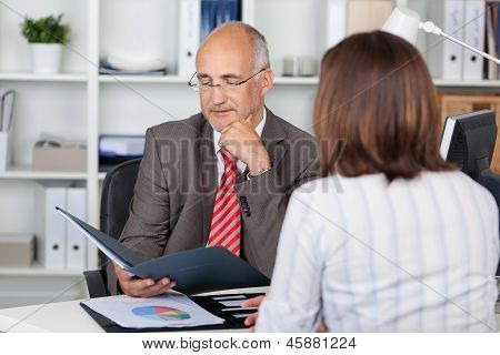 Businessman Looking At Cv