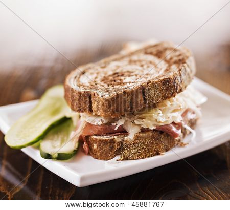 reuben sandwich with kosher dill pickle and coleslaw