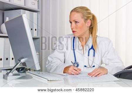 "a young �?�?�?�£ ""health care professional with stethoscope in her doctor's office."