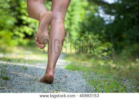 Woman's Feet Running On Gravel Road