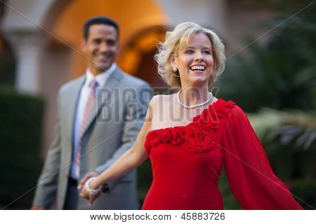 Woman Leading Man By The Hand