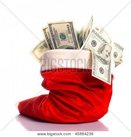 Christmas hat full of $100 dollar bill isolated on white