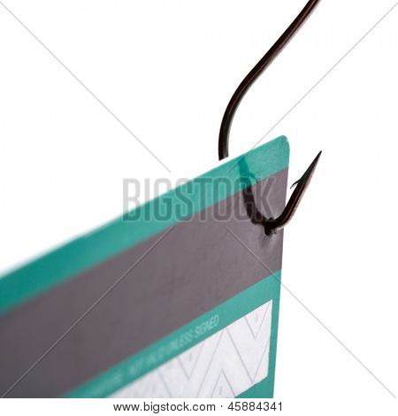 Closeup of a credit card caught on a fishing hook