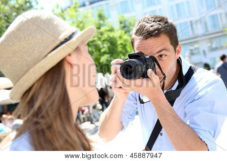 Man taking picture of girlfriend during week-end