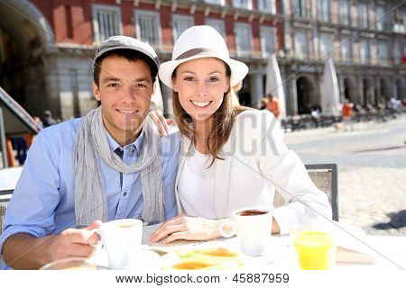 Tourists sitting at coffee shop in la Plaza Mayor, Madrid