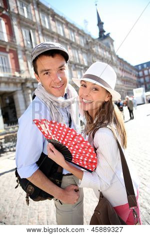 Cheerful couple enjoying tour in Madrid