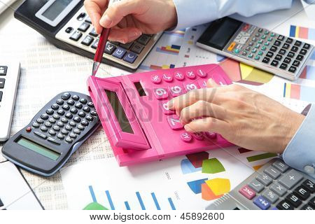 The Businesswoman And Calculators