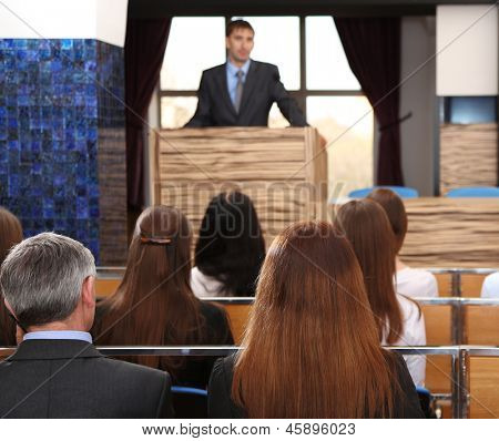 Business man is making a speech at conference room