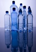 foto of plastic bottle  - Blue bottles of mineral water and water drops - JPG