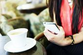 image of long distance  - Pretty young woman using mobile phone internet - JPG