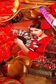 stock photo of castanets  - Flamenco woman with bullfighter and typical Spain Espana elements like castanets fan and comb - JPG