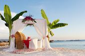 stock photo of cabana  - wedding table and set up with flowers on tropical beach - JPG