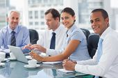 stock photo of meeting  - Smiling business people brainstorming  in the meeting room - JPG