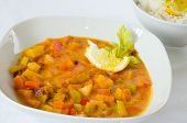 foto of rutabaga  - Dish of curry vegetables including rice and lemon as a complement - JPG