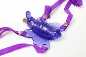stock photo of clitoris  - Purple butterfly sex toy made of rubber or latex - JPG