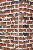 picture of mortar-joint  - A brick wall with mortar extruding from joints good for background or texture - JPG
