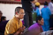 LHASA, TIBET-OCTOBER 08: A Buddhist pilgrim is reading mantra on bended knees in front of the holy J