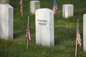 stock photo of arlington cemetery  - Gravestone of an unknown soldier in Arlington National Cemetery on Memorial Day - JPG