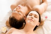 foto of cosmetology  - picture of couple in spa salon lying on the massage desks - JPG