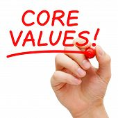 foto of conduction  - Hand writing Core Values with red marker on transparent wipe board - JPG
