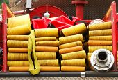 stock photo of fire-station  - Lay hose bed on a fire engine 5 inch supply hose - JPG