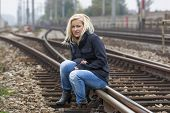 stock photo of unemployed people  - a young woman is sad - JPG