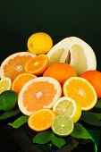 foto of pamelo  - Lots ripe citrus isolated on black - JPG