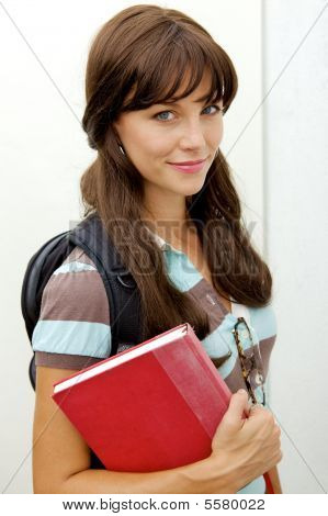 Cute School Girl With Books