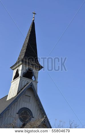 Church steeple against a clear blue sky
